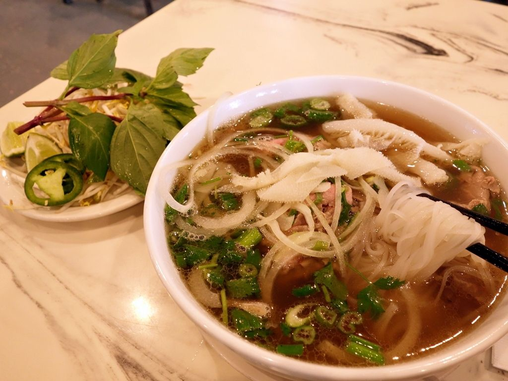 A bowl of pho with greens on the side at Pho So 1