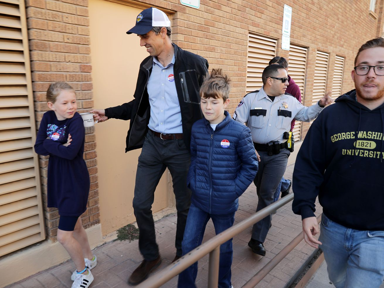 Beto O'Rourke and his children Molly (left) and Ulysses leave their neighborhood polling place after voting on November 6, 2018 in El Paso, Texas.