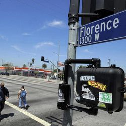This April 17, 2012 photo shows street signs at the intersection of Florence and Normandie Avenues in South-Central Los Angeles. The intersection was the location of much of the early violence in the Los Angeles riots that began on April 29, 1992, beginning with the beating of truck driver Reginald Denny. The acquittal of four police officers in the videotaped beating of Rodney King sparked rioting that spread across the city and into neighboring suburbs. Cars were demolished and homes and businesses were burned. Before order was restored, 55 people were dead, 2,300 injured and more than 1,500 buildings were damaged or destroyed.