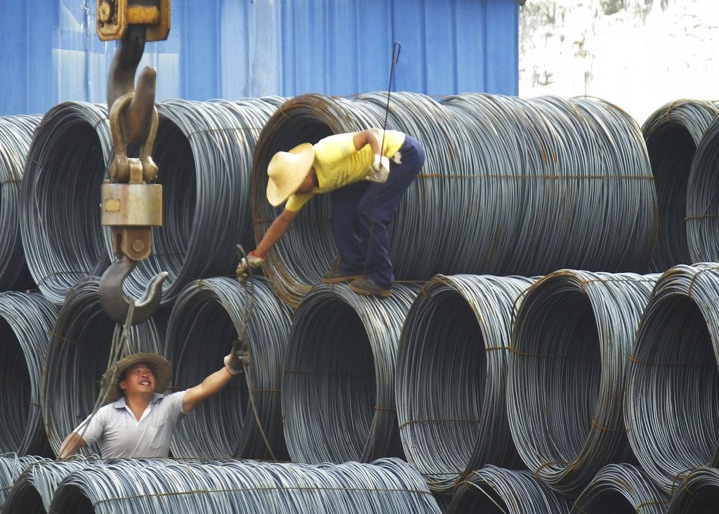 Laborers work in the steel market in Yichang in central China's Hubei province.(Chinatopix Via AP, File)