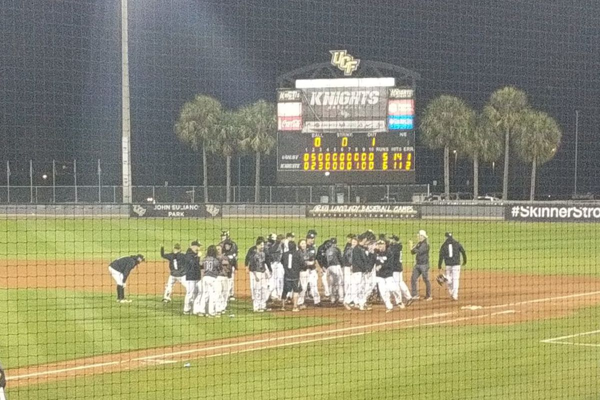 UCF Baseball celebrates in the seconds after its 6-5, 13-inning, walk-off win over Bradley on Tuesday night. (Photo: Brian Murphy)