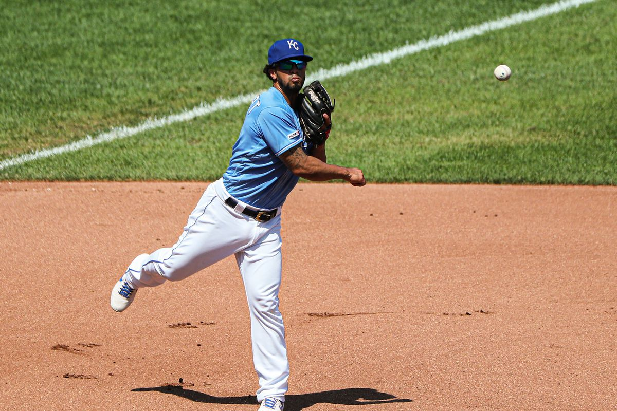Kansas City Royals third baseman Cheslor Cuthbert (19) throws to first base against the Detroit Tigers at Kauffman Stadium. Mandatory Credit: Jay Biggerstaff