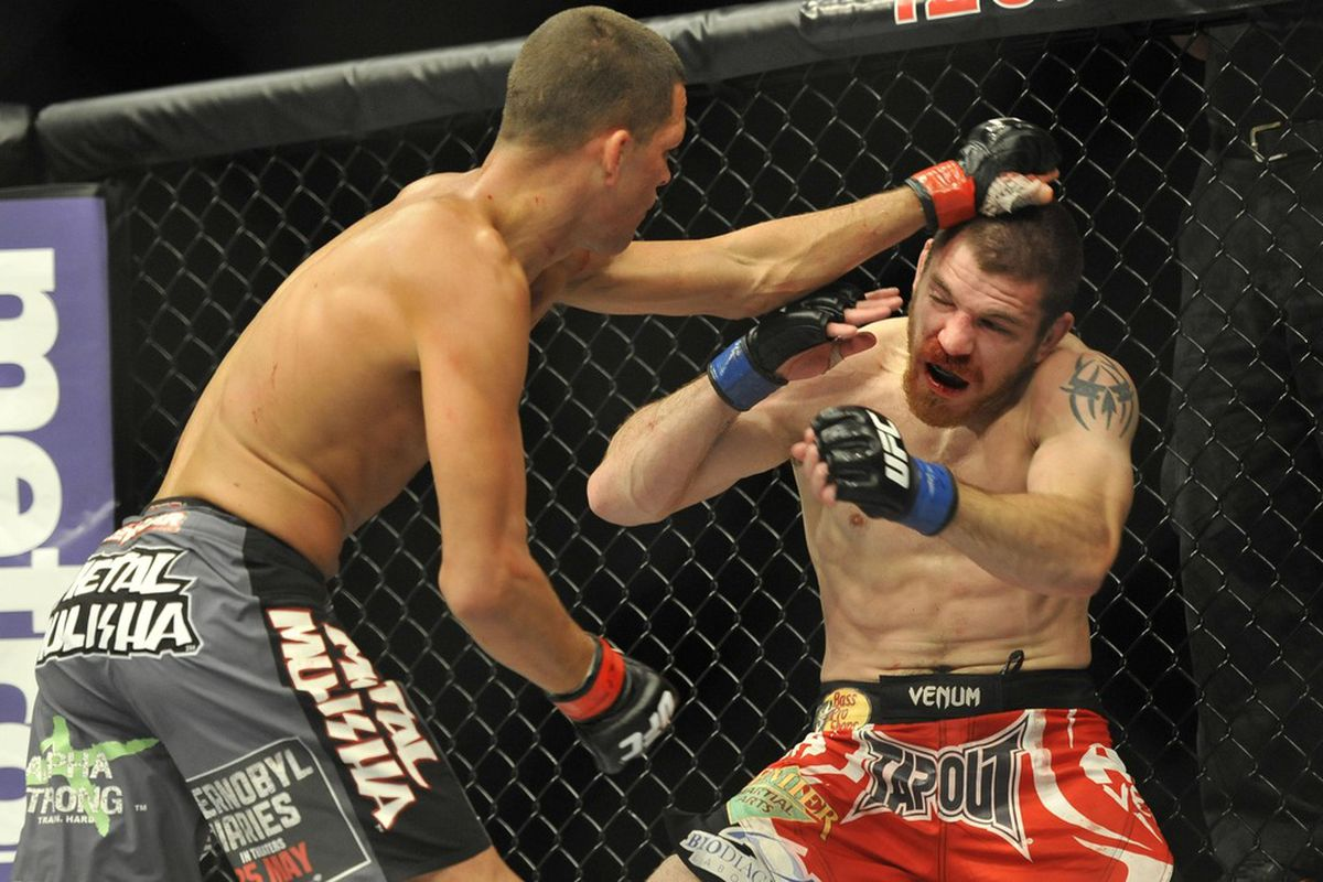 Nate Diaz (left) and Jim Miller fight during their lightweight bout during UFC on Fox 3 at the Izod Center. Nate Diaz wins by submission in round two Joe Camporeale-US PRESSWIRE