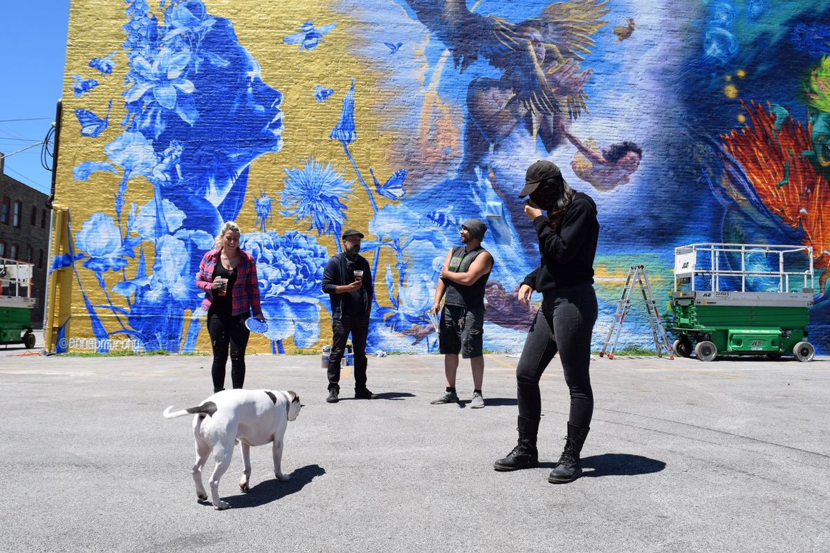 """The artists who painted """"The Four Elements"""" mural at 3101 E. 92nd St. (from left): Anna Murphy, Jesse Navarrete, Grigor Eftimov and Jasmina Cazacu."""