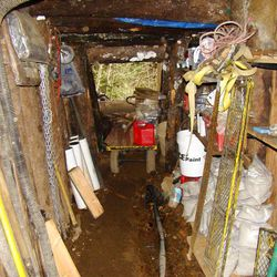 A man suspected of killing his wife and daughter hid from the police in this bunker for 22 hours.