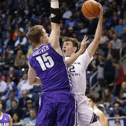 Brigham Young Cougars guard Zac Seljaas (2) drives on Portland Pilots center Philipp Hartwich (15) in Provo on Thursday, Dec. 28, 2017.
