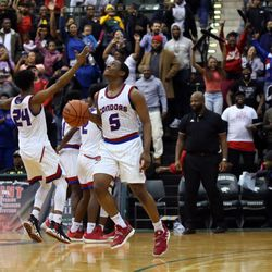 Curie's Trevon Hamilton (5) looks as the clock winds down to win the CPS championship, 65-60 over Morgan Park at Chicago State University in Chicago, Sunday, February 17, 2019. | Kevin Tanaka/For the Sun Times