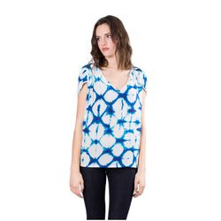 """<b>Kristen Philipkoski, Racked San Francisco Editor</b>: """"I love to tuck a light, flowy blouse into high-waisted pants or a skirt when I need to not look like a hippie. <b>The Podolls'</b> silk fabric is one of my favorites. This <a href=""""http://shopthepo"""