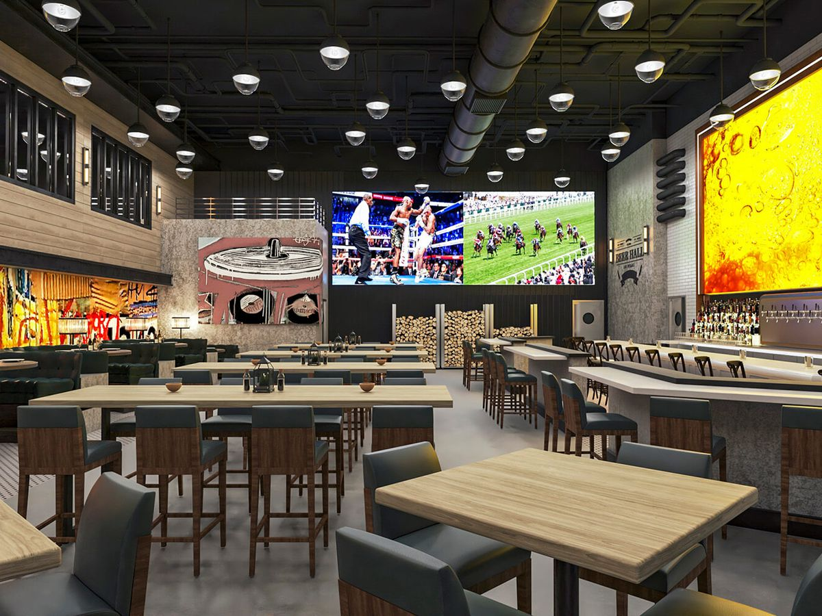 A sports book with a lot of TV screens
