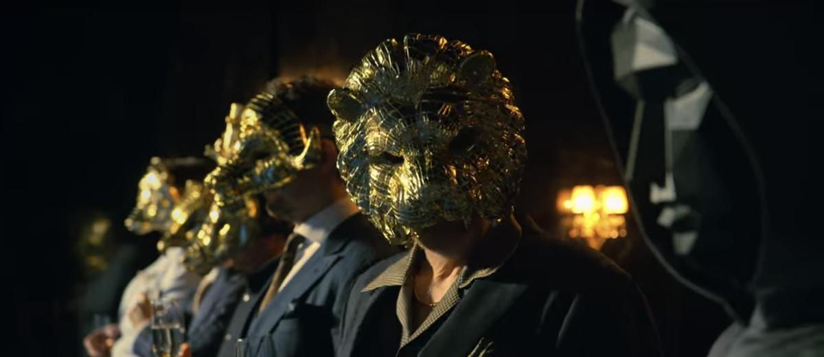 Observers in golden masks in Netflix's Squid Game