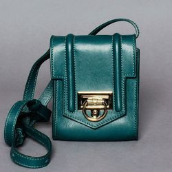 """NYC's It-clutch designer expands into other categories, with equally covetable results. Reece Hudson Siren <a href=""""http://reecehudson.com/collections/cross-body/products/siren-mini-bag?pcolor=sirenmini_green"""">mini bag</a>, $495."""
