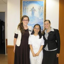 Kelsi Anderson and her companion are shown with Sister Lin Yu-Yu at her baptism.