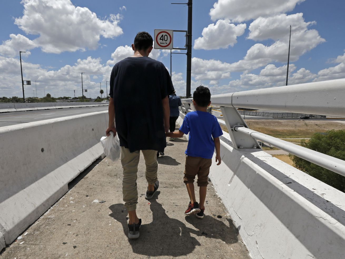 Inside the newsroom: We needed a 'fixer' to cover immigration at the border. Here's how and why we did it