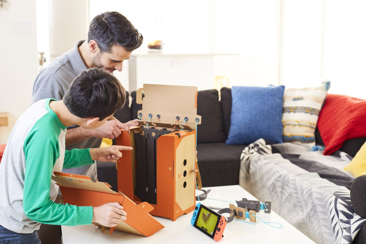Nintendo Labo - man and boy build robot suit backpack
