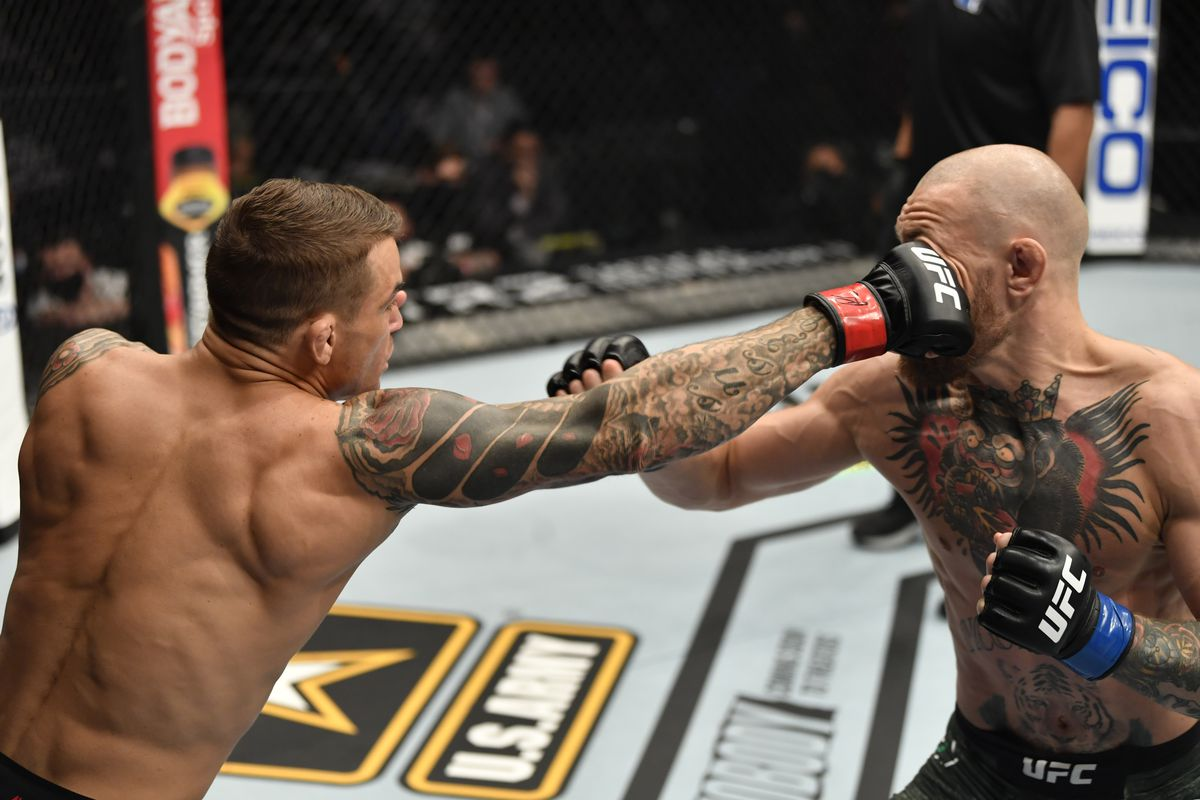 Dustin Poirier lands a jab on Conor McGregor at UFC 257 in Abu Dhabi.