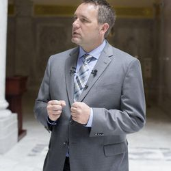 Former West Jordan police officer Aaron Jensen speaks to members of the media about winning a $2.7 million sexual discrimination lawsuit against West Jordan during a press conference at the Capitol in Salt Lake City on Thursday, June 22, 2017.