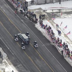 People watch as the funeral procession for Unified police officer Doug Barney makes its way through Holladay, where Barney served, on its way to the Orem City Cemetery, where he will be laid to rest on Monday, Jan. 25, 2016. Barney was shot and killed in the line of duty by a man who seemingly had done nothing more than leave the scene of a traffic accident Sunday, Jan. 17, 2016.