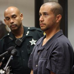 FILE - In this Thursday, April 12, 2012 file photo, George Zimmerman, right, stands next to a Seminole County Deputy during a court hearing in Sanford, Fla. Zimmerman, the neighborhood watch volunteer charged with murdering Trayvon Martin, has a bond hearing scheduled for Friday, April 20, 2012. Whether Zimmerman is allowed to leave Seminole County as he awaits trial, and how he will remain safe, are two questions that likely are going to be at the center of the hearing at the Seminole County Criminal Justice Center, legal experts say.