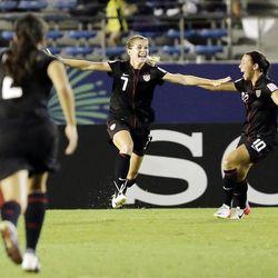Alta High grad Kealia Ohai, center, celebrates with Vanessa Di Bernardo (10) after she scored a goal against Germany.