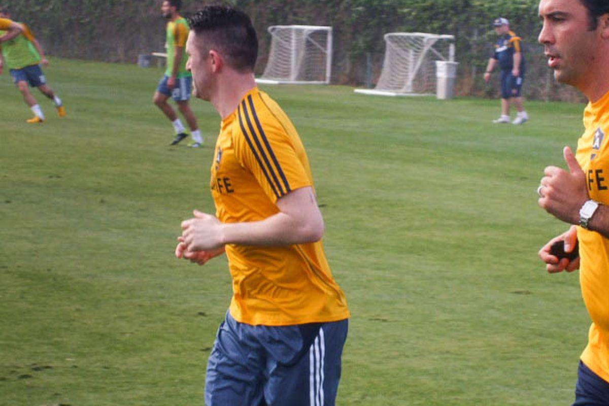Robbie Keane jogs around the LA Galaxy practice pitch