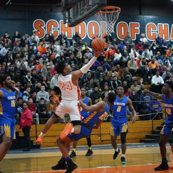 Young's Tyler Beard (24) gets  reverse layup against Simeon, Wednesday 02-13-19. Worsom Robinson/For the Sun-Times.
