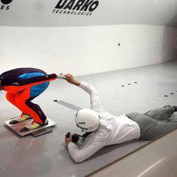 Women's Ski Jumping USA team member Lindsey Van and her coach, Alan Alborn, adjust her hand's position inside a wind tunnel built by Layne Christensen, founder of Darko Technologies, in Ogden's Business Depot on Thursday, Sept. 26, 2013.