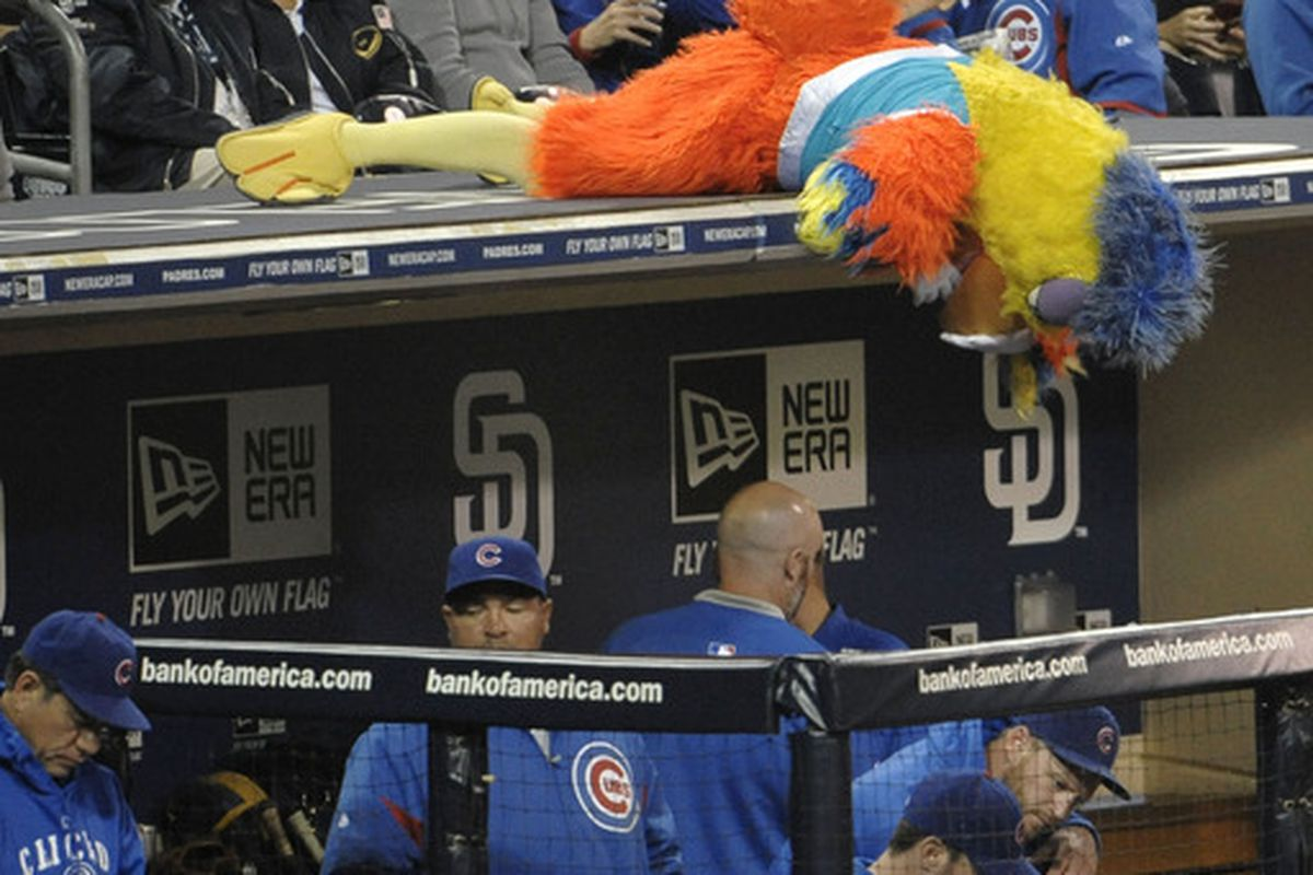 The San Diego Chicken looks into the Chicago Cubs dugout  during the sixth inning of a baseball game against the San Diego Padres at Petco Park in San Diego, California.  (Photo by Denis Poroy/Getty Images)