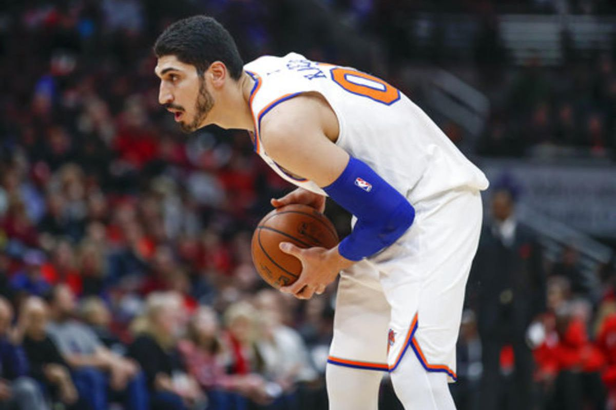 New York Knicks center Enes Kanter looks to pass the ball against the Chicago Bulls during the first half of an NBA basketball game, Saturday, Dec. 9, 2017, in Chicago.