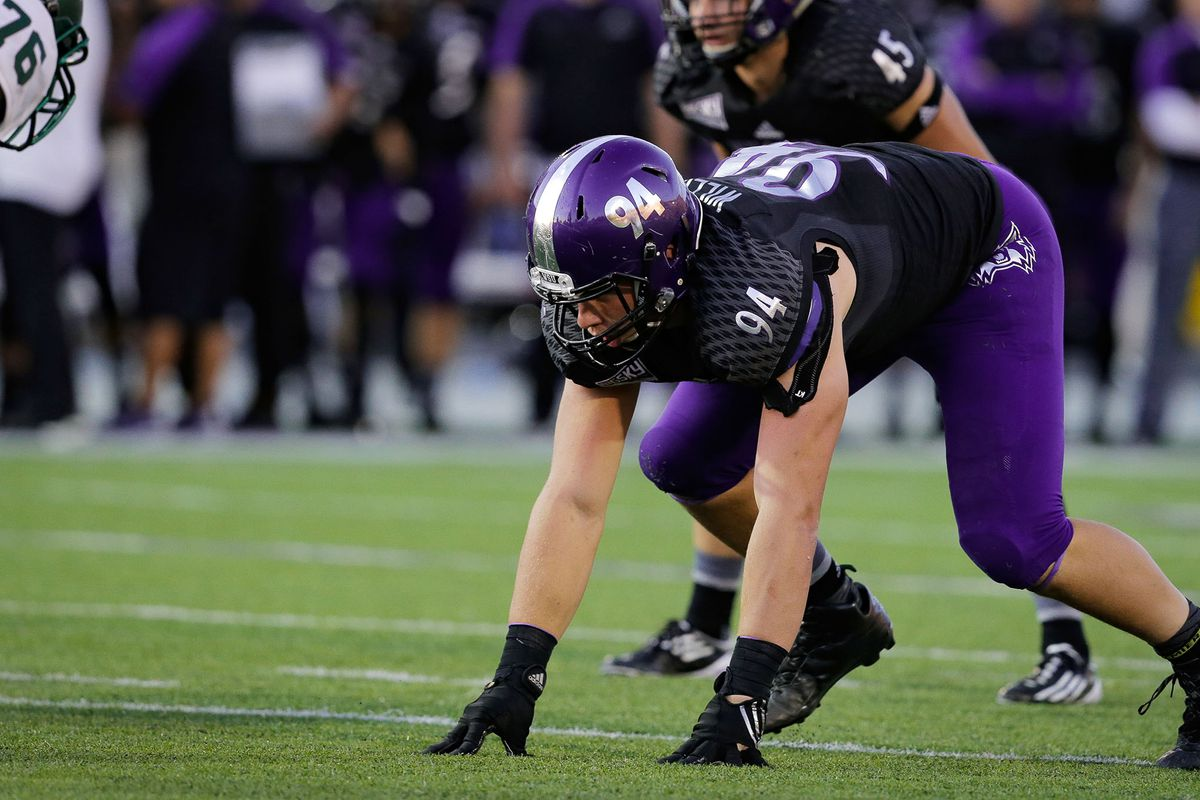Weber State sophomore Jonah Williams takes his position on the defensive line. Williams is one of more than 100 returned Mormon missionaries playing college football at the FCS level, Division II or Division III.