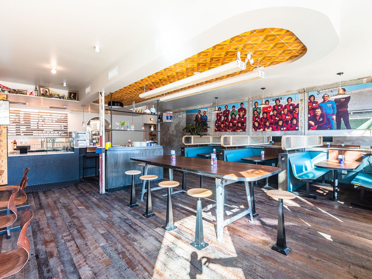 A communal tables and bowling alley-style booths at Sonny's