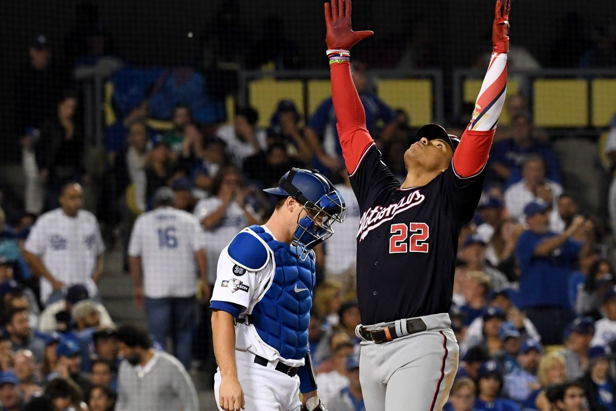 Washington Nationals outfielder Juan Soto celebrates as he crosses the plate after hitting a home run off of Los Angeles Dodgers pitcher Clayton Kershaw to tie the game in the eighth inning of game five of the NLDS at Dodger Stadium.