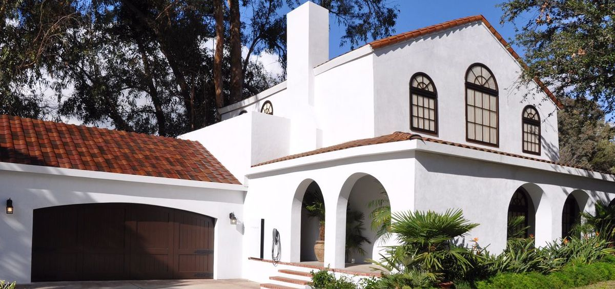 A photo of a home with the Tuscan solar panels, which look like any other roof tiling