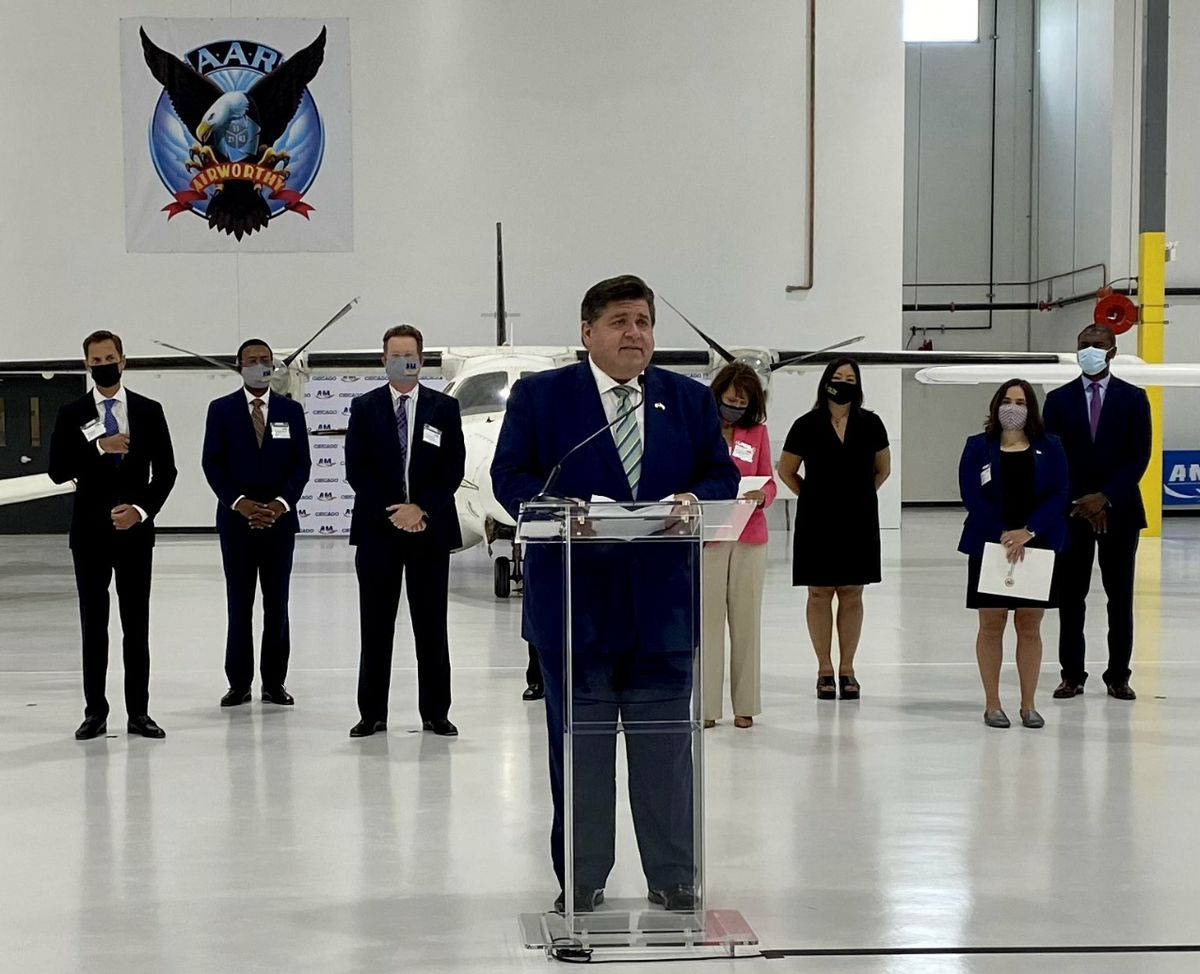Gov. J.B. Pritzker speaks at the ribbon-cutting ceremony at the Aviation Institute of Maintenance's new training center, at 3711 S. Ashland on Wednesday.