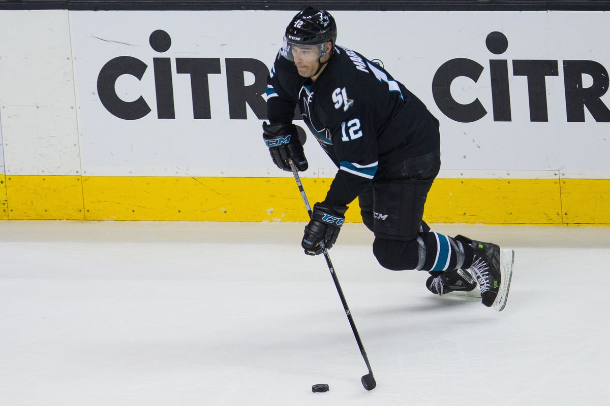 Mar 16, 2017; San Jose, CA, USA; San Jose Sharks left wing Patrick Marleau (12) drives the puck up ice towards the St. Louis Blues net in the second period at SAP Center at San Jose.