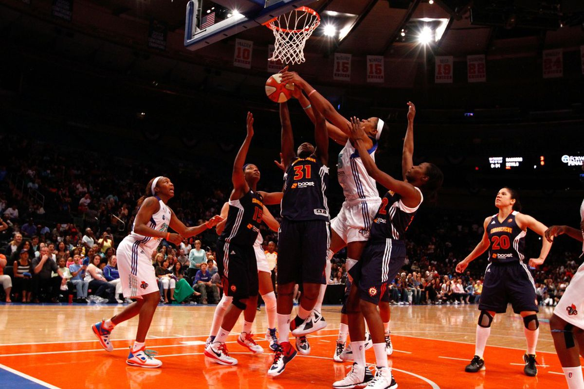 May 19, 2012; New York, NY, USA; New York Liberty center Kia Vaughn (15) is fouled by Connecticut Sun center Tina Charles (31) during the second half at Madison Square Garden. Sun won 78-73. Mandatory Credit: Debby Wong-US PRESSWIRE