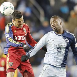 Real's Javier Morales and Kansas City's C.J. Sapong head the ball as Real Salt Lake and Sporting KC play Saturday, Dec. 7, 2013 in MLS Cup action. Sporting KC won in a shootout.