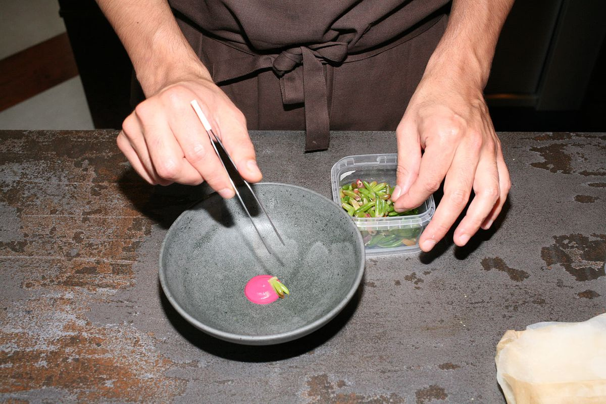 """Chef Santiago Lasta plates a """"pink mole"""" of pine nuts, beetroot, and smoked chiles at Kol in Marylebone"""