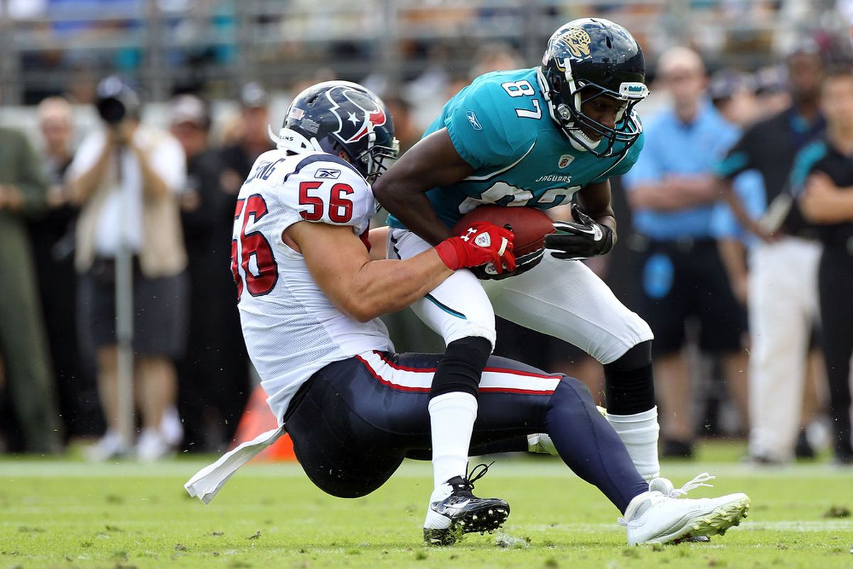 JACKSONVILLE, FL - NOVEMBER 27:   Brian Cushing #56 of the Houston Texans tackles  Jarett Dillard #87 of the Jacksonville Jaguars during the game at EverBank Field on November 27, 2011 in Jacksonville, Florida.  (Photo by Sam Greenwood/Getty Images)