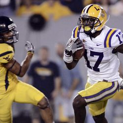 FOR USE AS DESIRED WITH NFL DRAFT STORIES - FILE - In this Sept. 24, 2011, file photo, LSU's Morris Claiborne  (17) returns a punt for a touchdown against West Virginia during the third quarter of an NCAA college football game in Morgantown, W.Va. Claiborne is a top prospect in the upcoming NFL football draft.
