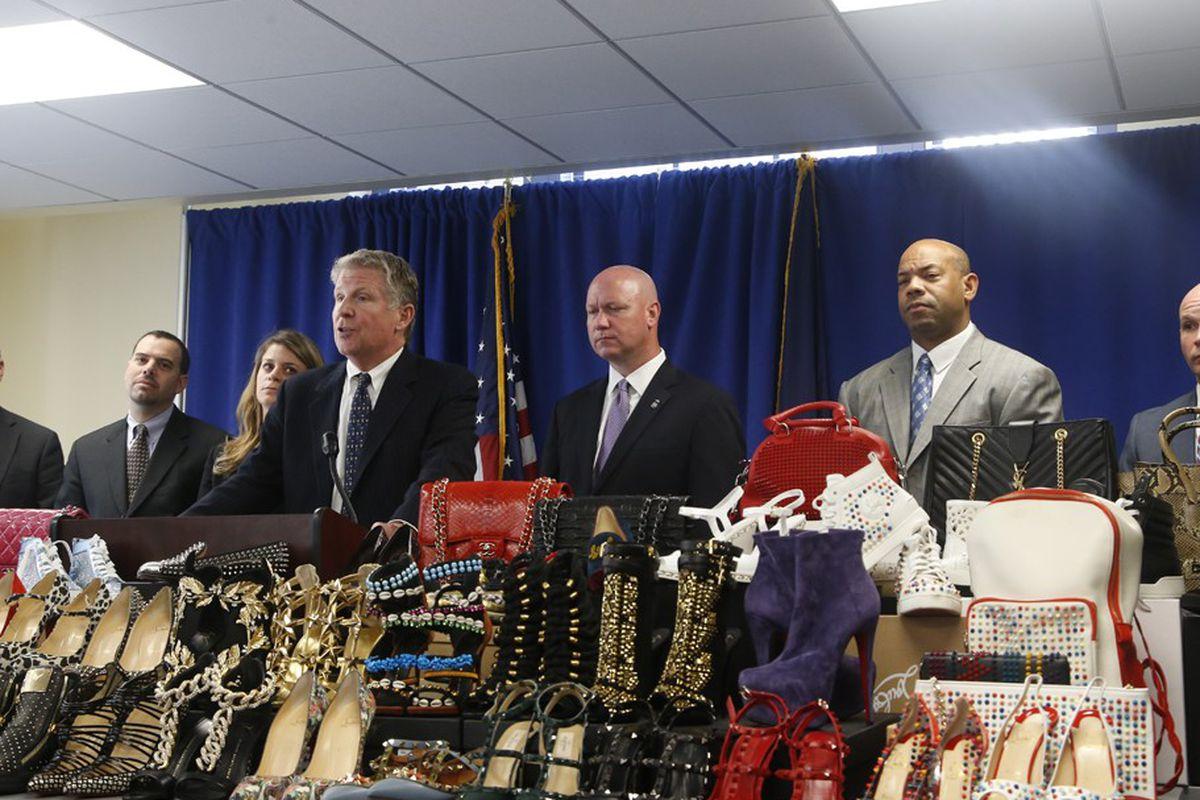 "Photos: <a href=""http://www.wwd.com/business-news/legal/five-indicated-in-saks-theft-scheme-7969802"">WWD</a>"