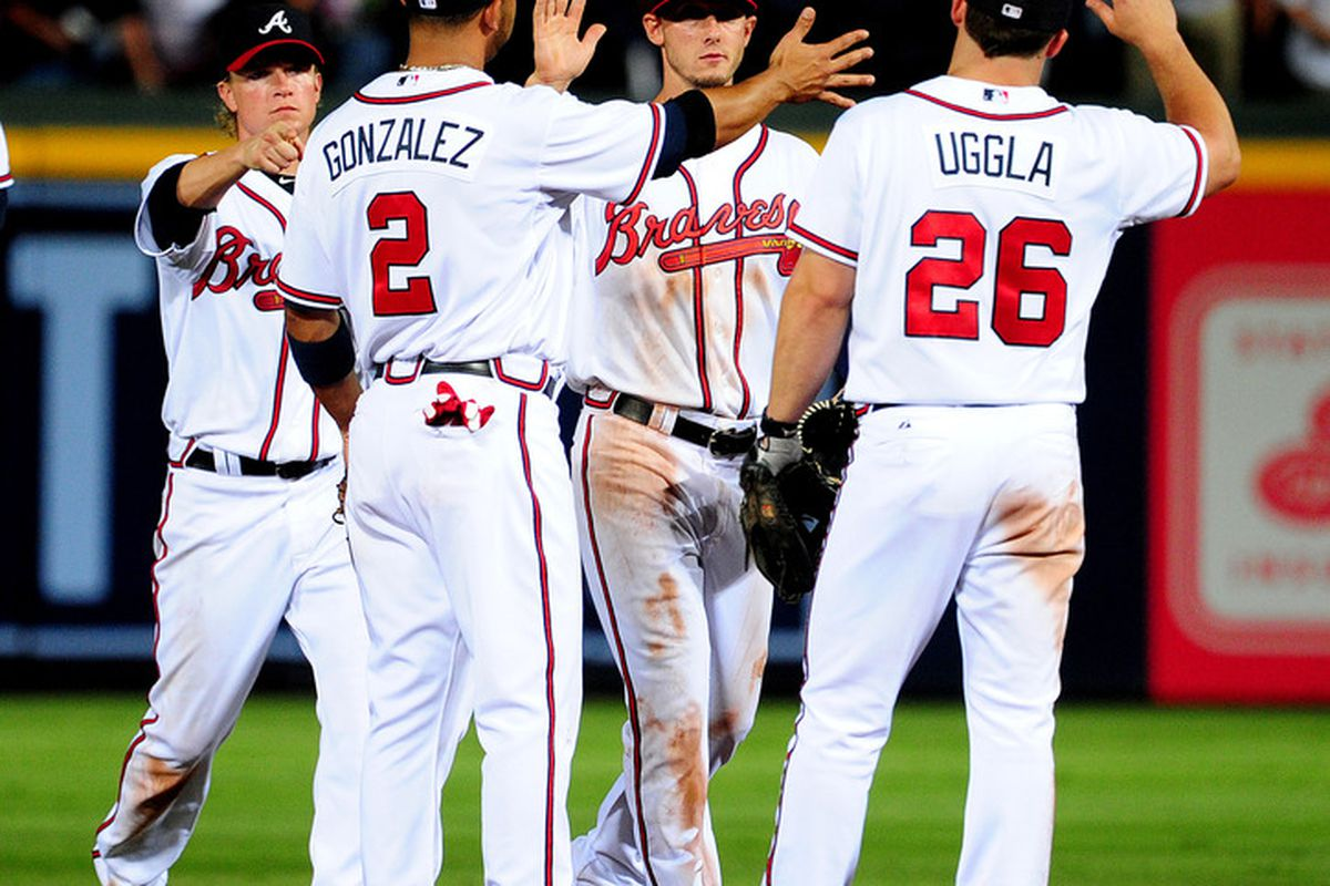 ATLANTA - JULY 6: Members of the Atlanta Braves celebrate after the game against the Colorado Rockies at Turner Field on July 6, 2011 in Atlanta, Georgia. (Photo by Scott Cunningham/Getty Images)