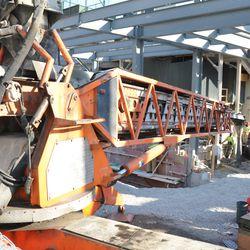 Concrete conveyor working under the left center field bleachers -