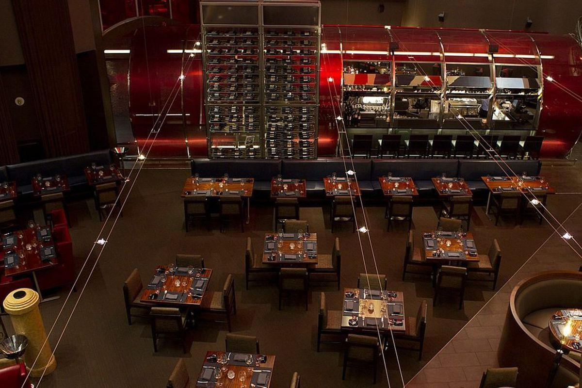 A view from the second floor looking down at the bar and dining room at Gordon Ramsay Steak.