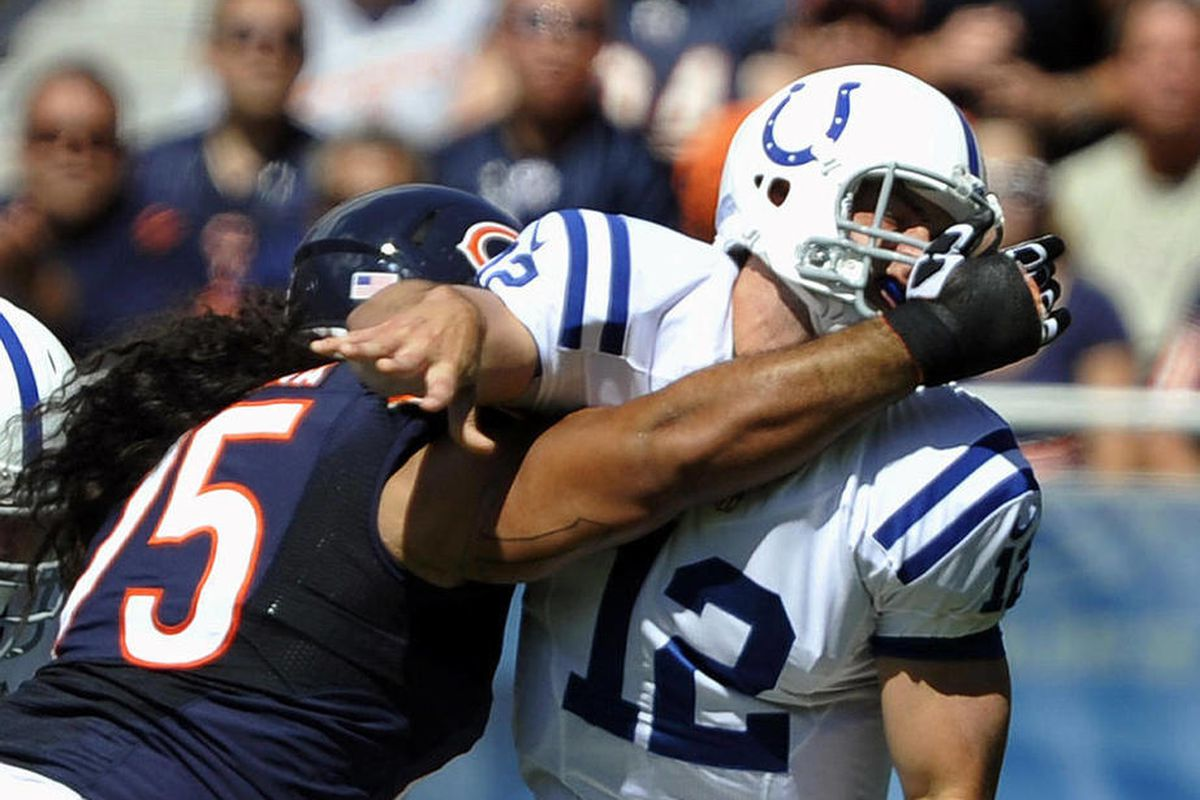 Indianapolis Colts quarterback Andrew Luck (12) is pressured by Chicago Bears defensive tackle Matt Toeaina (75) as he releases a pass during the first half of an NFL football game in Chicago, Sunday, Sept. 9, 2012.