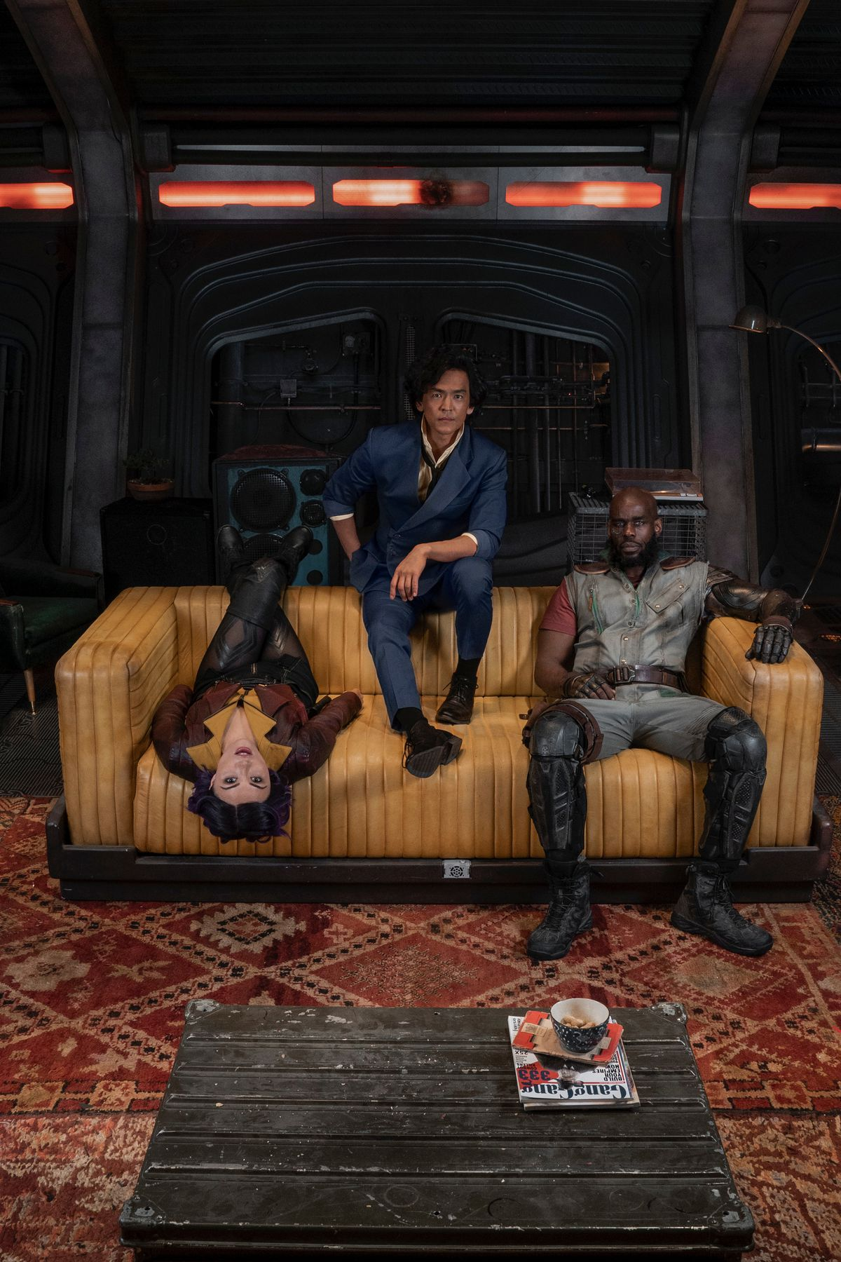 The cast of Netflix's Cowboy Bebop sitting on a couch