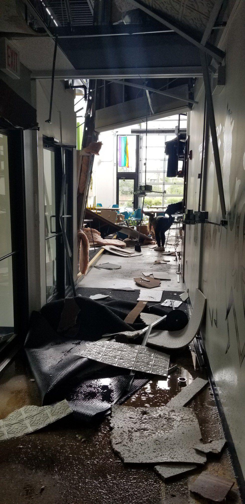 A hallway damaged by a storm