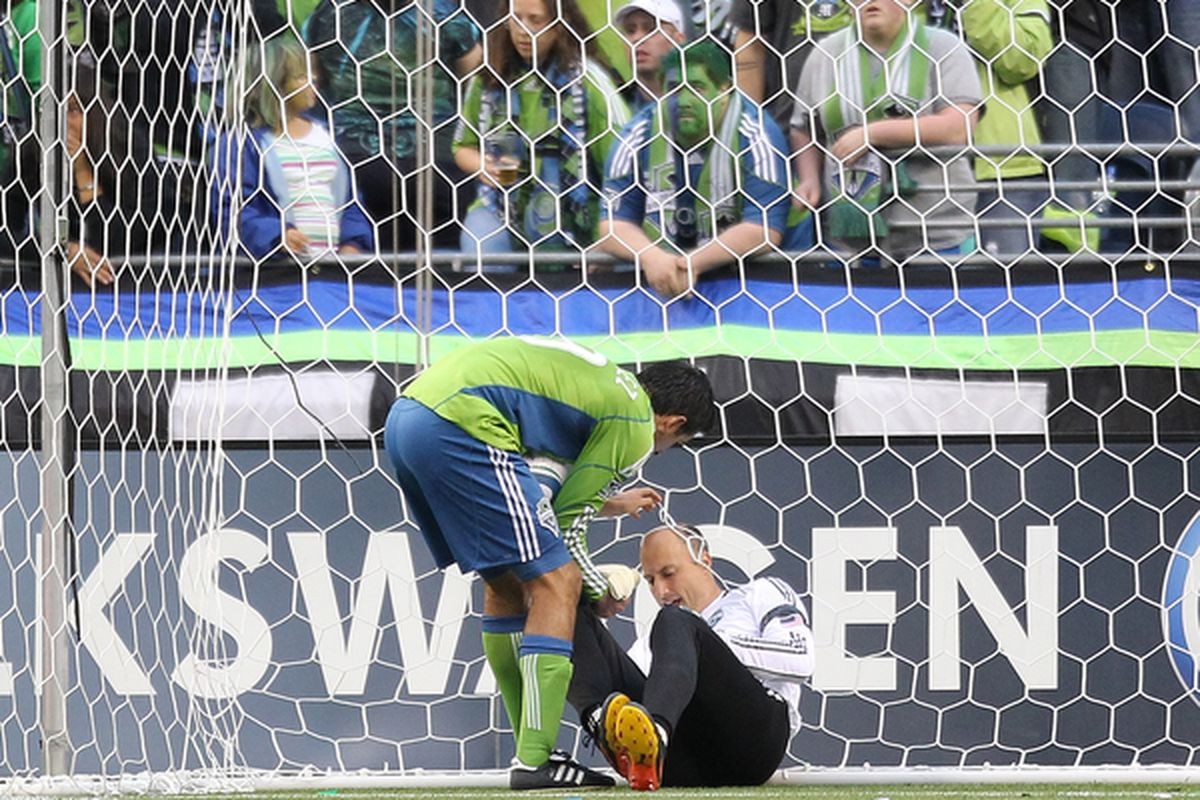 SEATTLE - JUNE 10:  Leo helps Kasey back to his feet after a goal is scored against the Sounders. Let us not repeat this performance. (Photo by Otto Greule Jr/Getty Images)