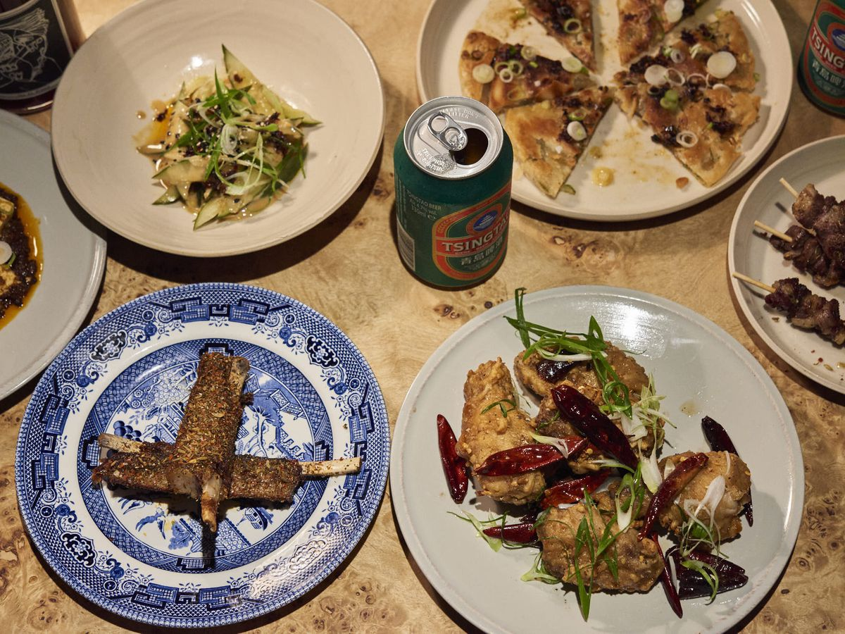 A selection of skewers, flatbreads, and roast meats at London tasting menu restaurant The Laughing Heart