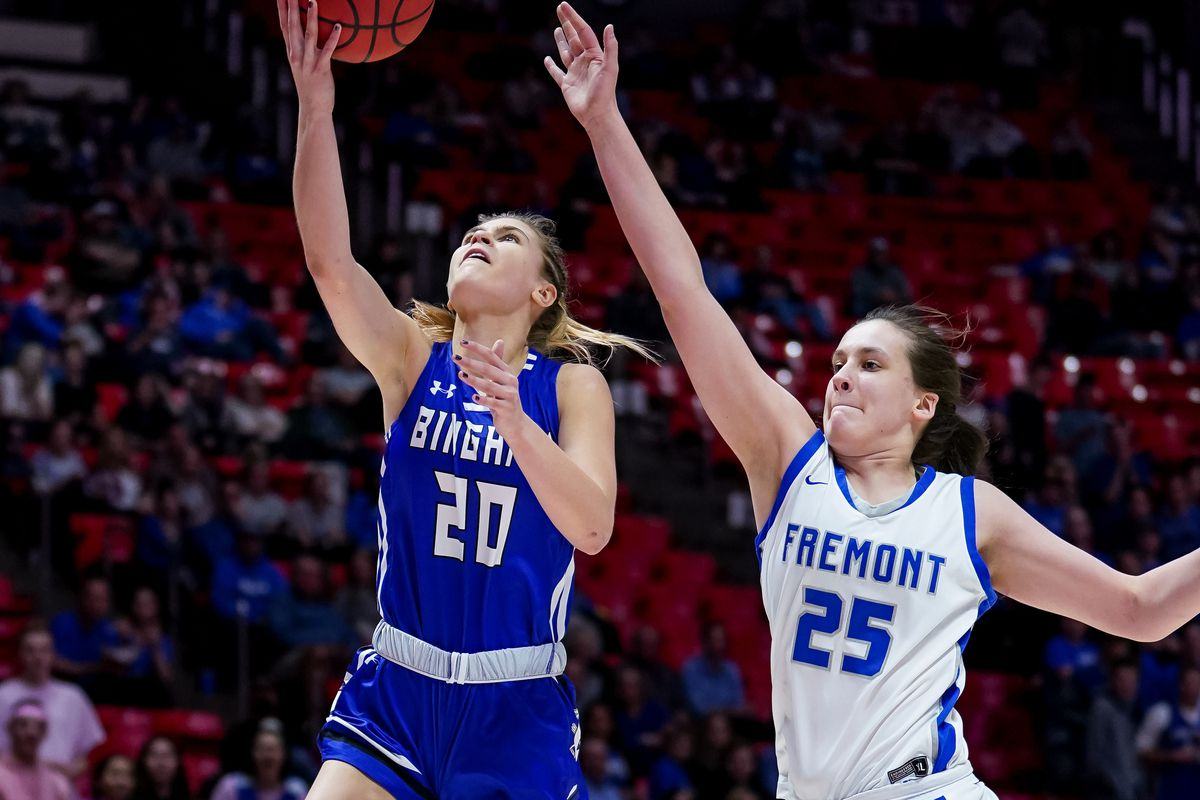 Bingham's Sierra Lichtie goes to the hoop ahead of Fremont's Emma Calvert in the 6A girls basketball championship game at the Huntsman Center in Salt Lake City on Saturday, Feb. 29, 2020.