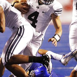 Taysom Hill of the Brigham Young Cougars runs the ball against Boise during NCAA football in Boise, Thursday, Sept. 20, 2012.